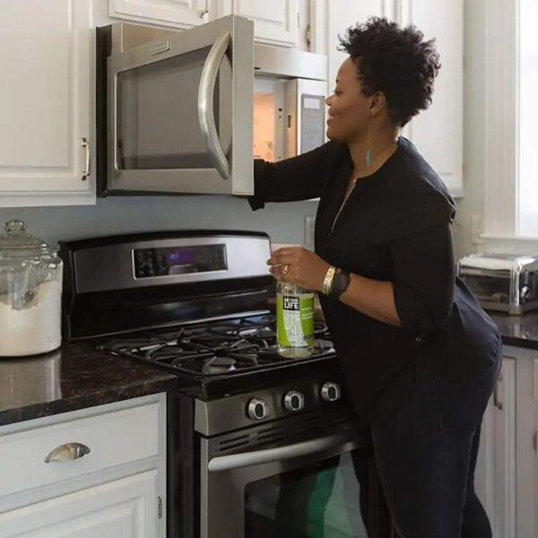 Lady cleaning microwave